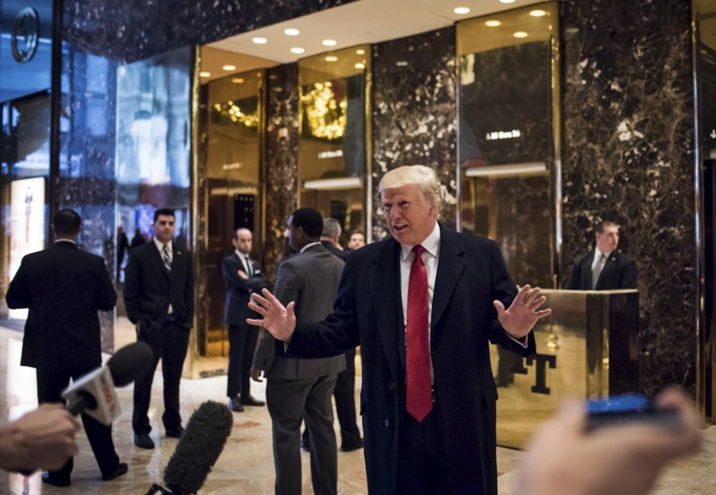 President-elect Donald Trump walks into the lobby of Trump Tower on Fifth Avenue Tuesday morning in New York, Dec. 6, 2016. (Hilary Swift/The New York Times)