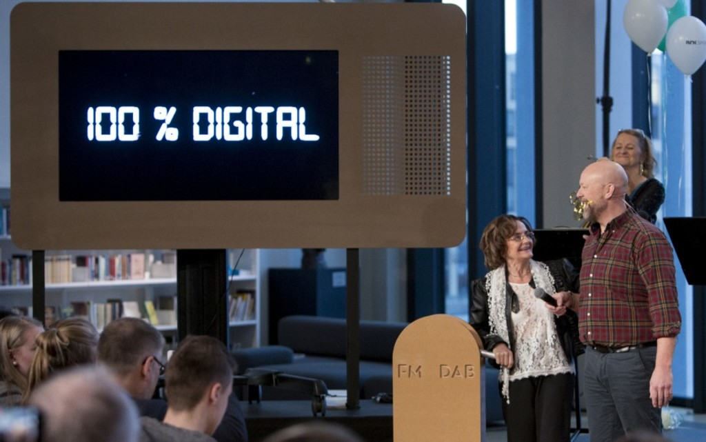 Norwegian radio hosts, Berit Olderskog and Geir Schau, shut down the northern part of Norway's FM radio network in favor of digital radio at a seremony in Bodo, Norway January 11, 2017.Norway is the forst country in the world to phase out its analog radio in favor of DAB. / AFP PHOTO / NTB Scanpix / Jan Morten BJORNBAKK / Norway OUT
