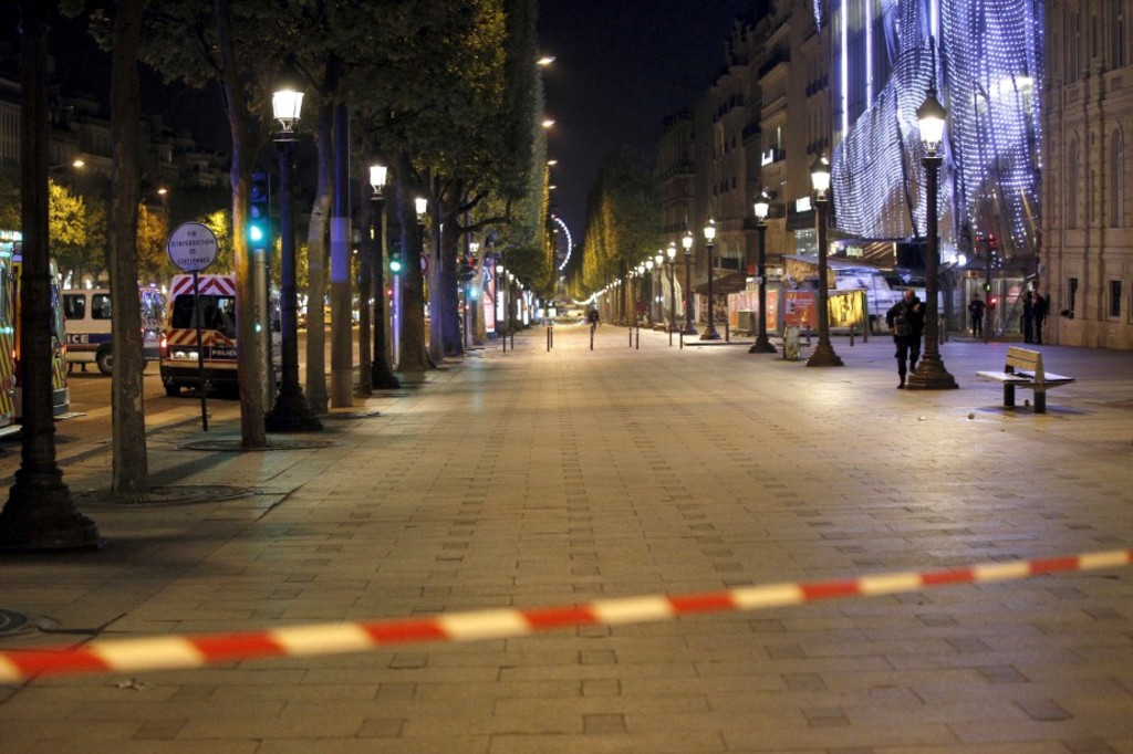 Police seal off the Champs Elysees avenue in Paris, France, after a fatal shooting in which a police officer was killed along with an attacker, Thursday, April 20, 2017. French media are reporting that two police officers were shot Thursday on the famed shopping boulevard. Many police vehicles can be seen on the avenue that passes many of the city's most iconic landmarks. (AP Photo/Thibault Camus)