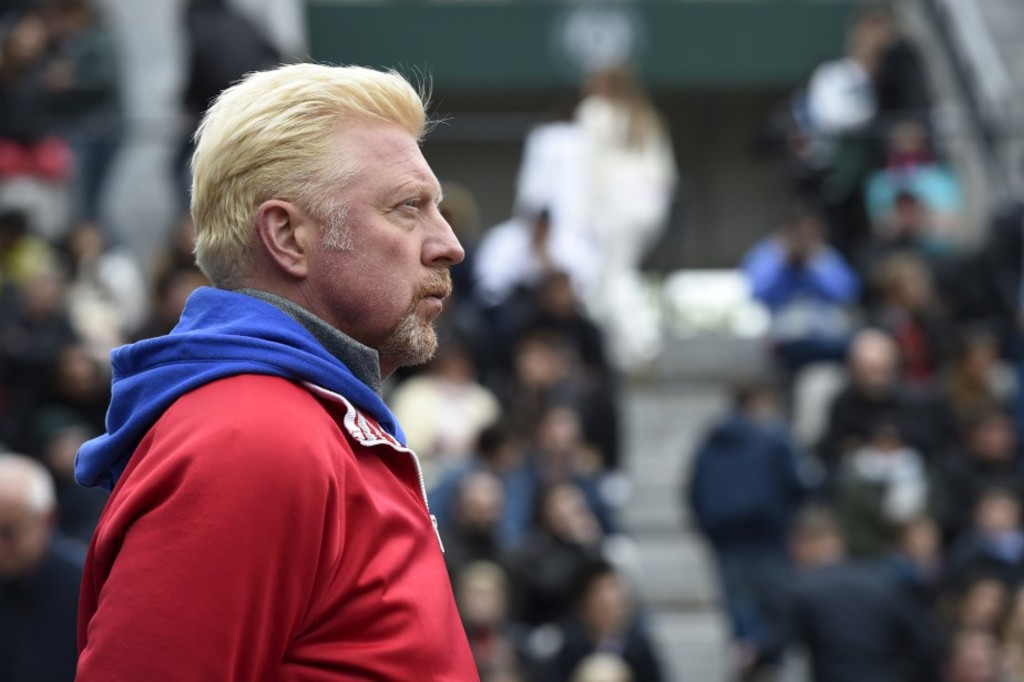 """(FILES) This file photo taken on June 3, 2016 shows German former tennis player Boris Becker attending the men's semi-final match between Austria's Dominic Thiem and Serbia's Novak Djokovic at the Roland Garros 2016 French Tennis Open in Paris.Former German tennis star Boris Becker has been declared bankrupt by a court in London after failing to pay a """"substantial"""" long-standing debt since 2015. / AFP PHOTO / MIGUEL MEDINA"""