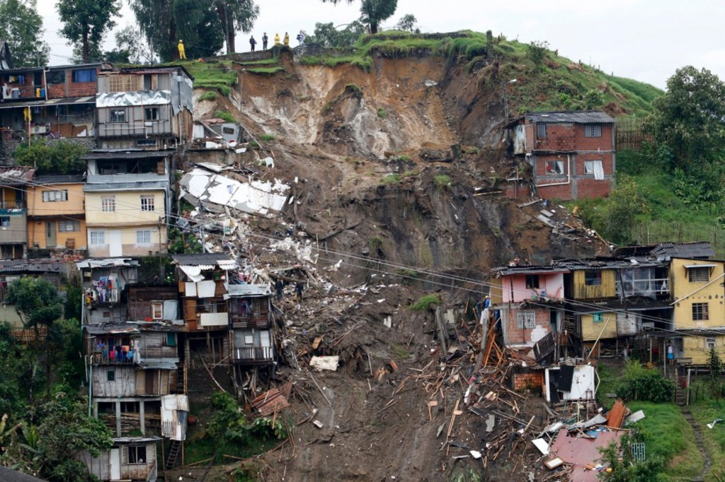 TOPSHOT - General view after mudslides in Manizales, Caldas department, Colombia on April 19, 2017.Flooding and mudslides in central Colombia have killed at least eleven people, the Red Cross said Wednesday, causing alarm in a country still recovering from mudslides that killed hundreds / AFP PHOTO / STRINGER