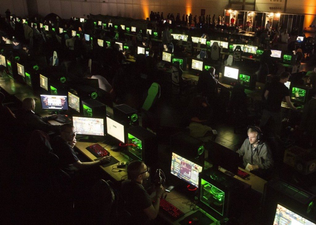 Players sit in front of  their computers at the computer game festival DreamHack in Leipzig , Germany, Friday, Jan. 13, 2017. DreamHack Leipzig is the official German platform of the Swedish DreamHack, one of the world's largest e-sports festivals, with events in countries including Sweden, France, Britain, Spain and Romania. (AP Photo/Jens Meyer)