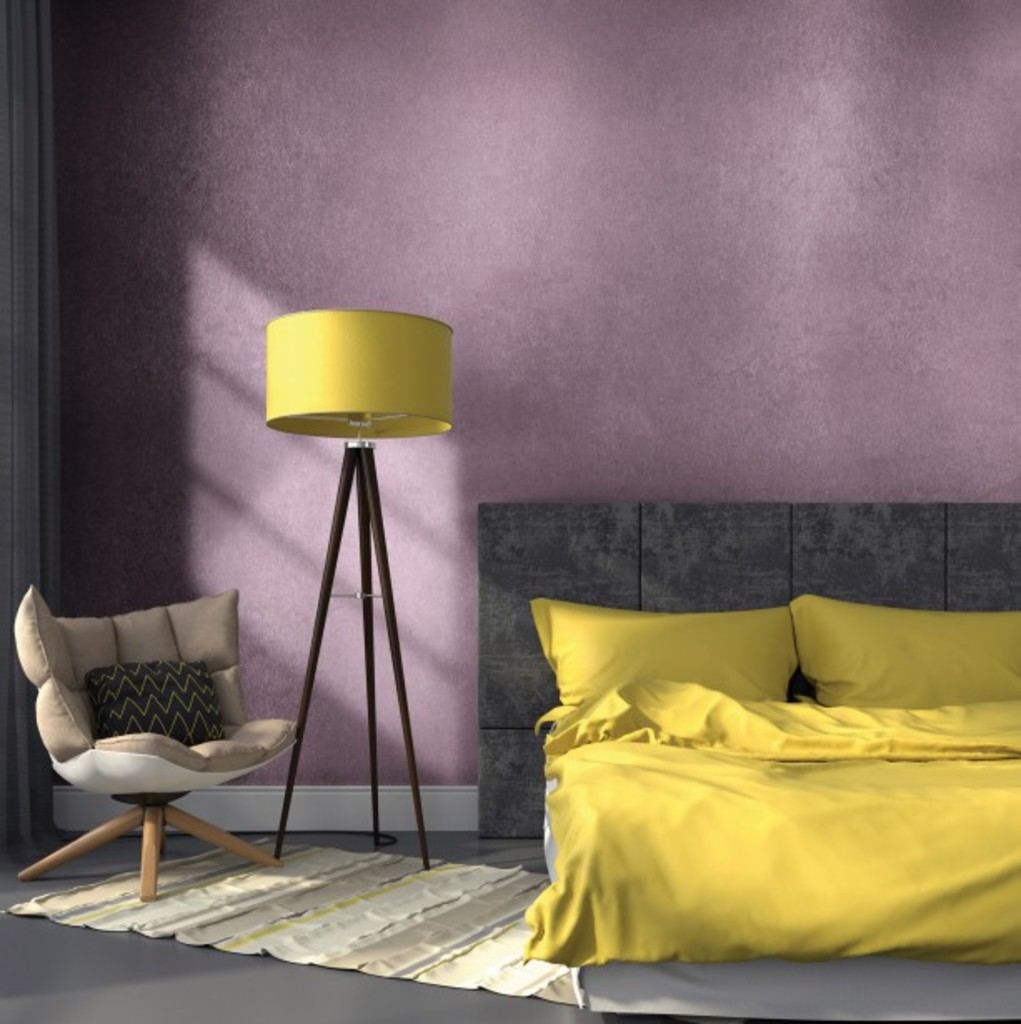 Modern bedroom in gray color and accents on yellow lamp and bedclothes